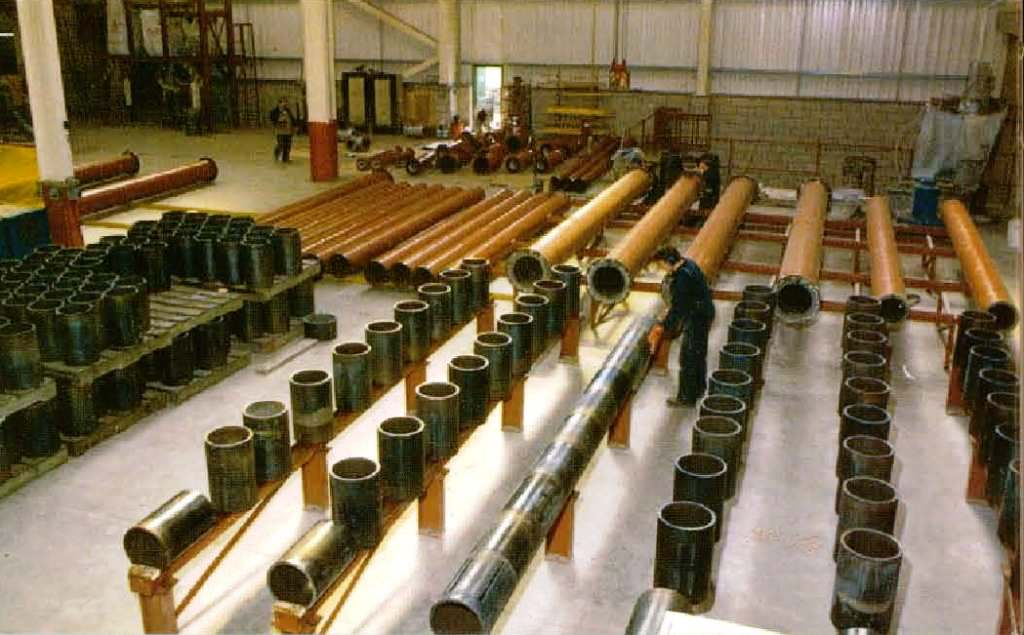 Lining steel pipe with cast basalt liners